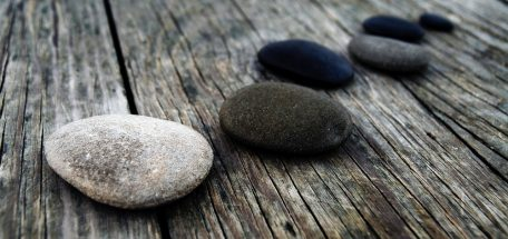 Smooth pebbles on wooden pier
